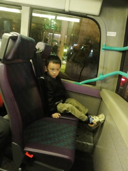 His favorite seat on the bus: top floor, front row. Thank goodness all the buses were double deckers