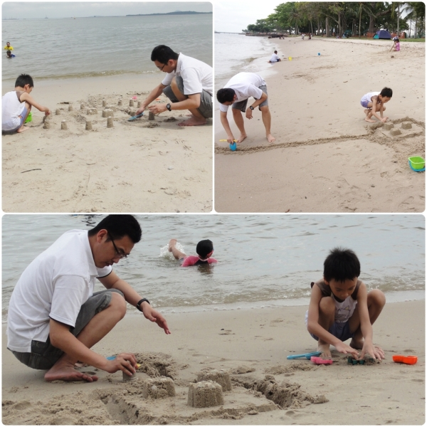 Making sand castle with daddy