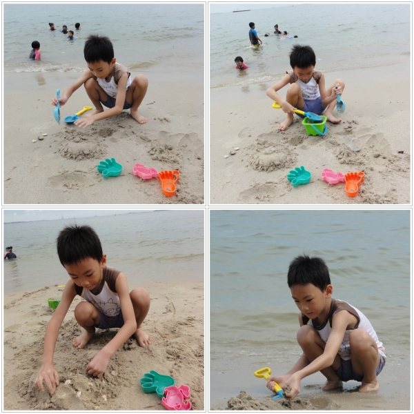 Enjoying his time playing with the sand