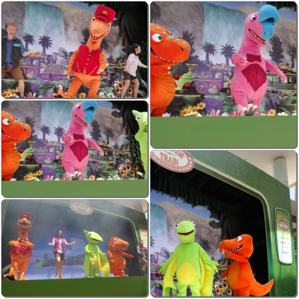 Four dinos on stage.....singing and dancing with all the children