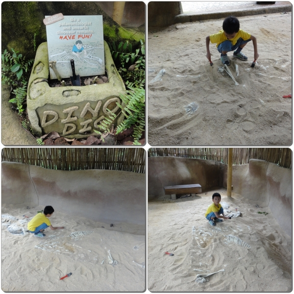 Being a paleontologist by digging for fossils on the sand. Soap and water are provided near this dino dig