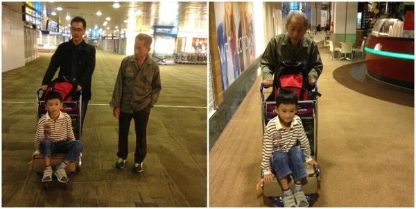 Lil boy insisted that we pushed him everywhere with this luggage cart