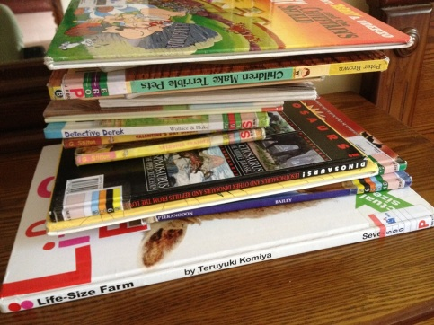 Our stack of books from the library