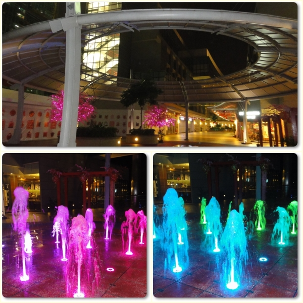 Twinkling pink trees and dancing water fountain