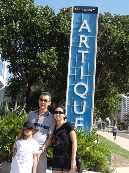In front of the signage of our first hotel