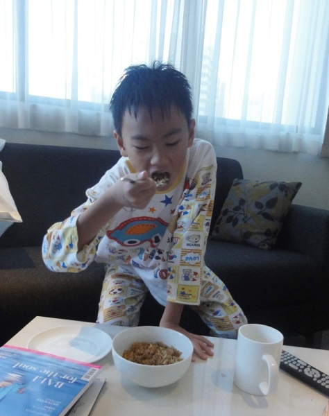 He was enjoying his fried rice on the sofa and in front of the TV.............well, it was a holiday, so it was okay for me