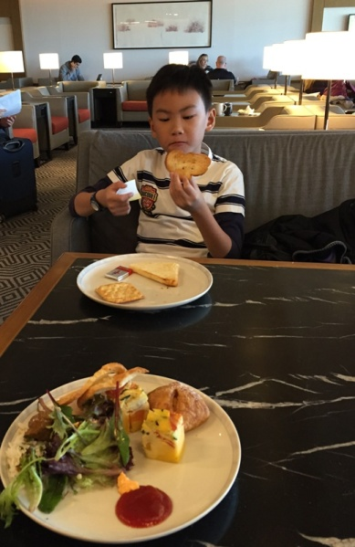 This boy preferred bread unlike his parents who chose rice, noodle, and beehoon. This lounge even served chili............