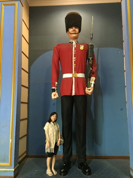 Why the guard is so big and tall................and red???