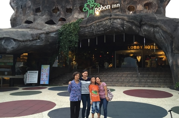 Family picture in front of Pohon Inn Hotel