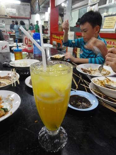 Es jeruk kelapa muda (orange juice with young coconut)