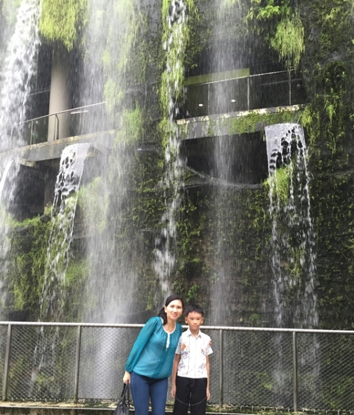Taking pictures in front of the waterfall is a must when you visit Cloud Forest.........