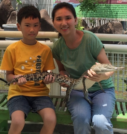 Free photo with a real alligator. Don't ask me how did I finally get my courage to touch this animal............