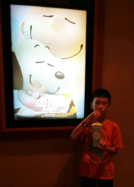 Just like Snoopy and Charlie Brown, movie and popcorn are best friends............