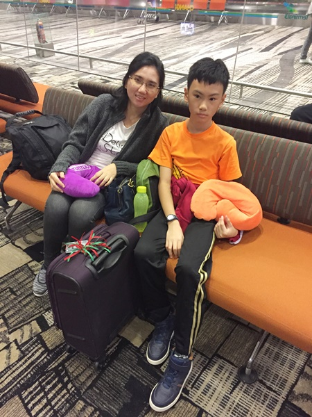 Changi Airport midnight time............we were ready to go and brought 2 neck pillows from home