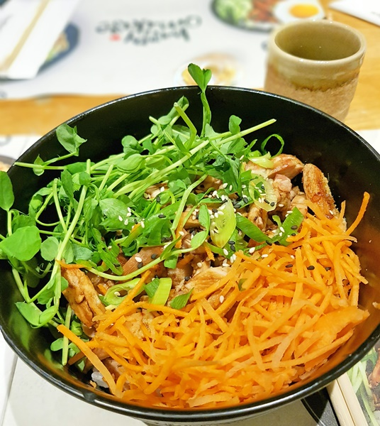 Daddy's order was Teriyaki chicken donburi: chicken in teriyaki sauce with sticky white rice, shredded carrots, pea shoots and onions. garnished with sesame seeds and served with a side of kimchee