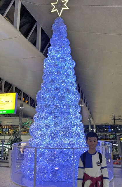 Blue Christmas tree inside Heathrow Airport